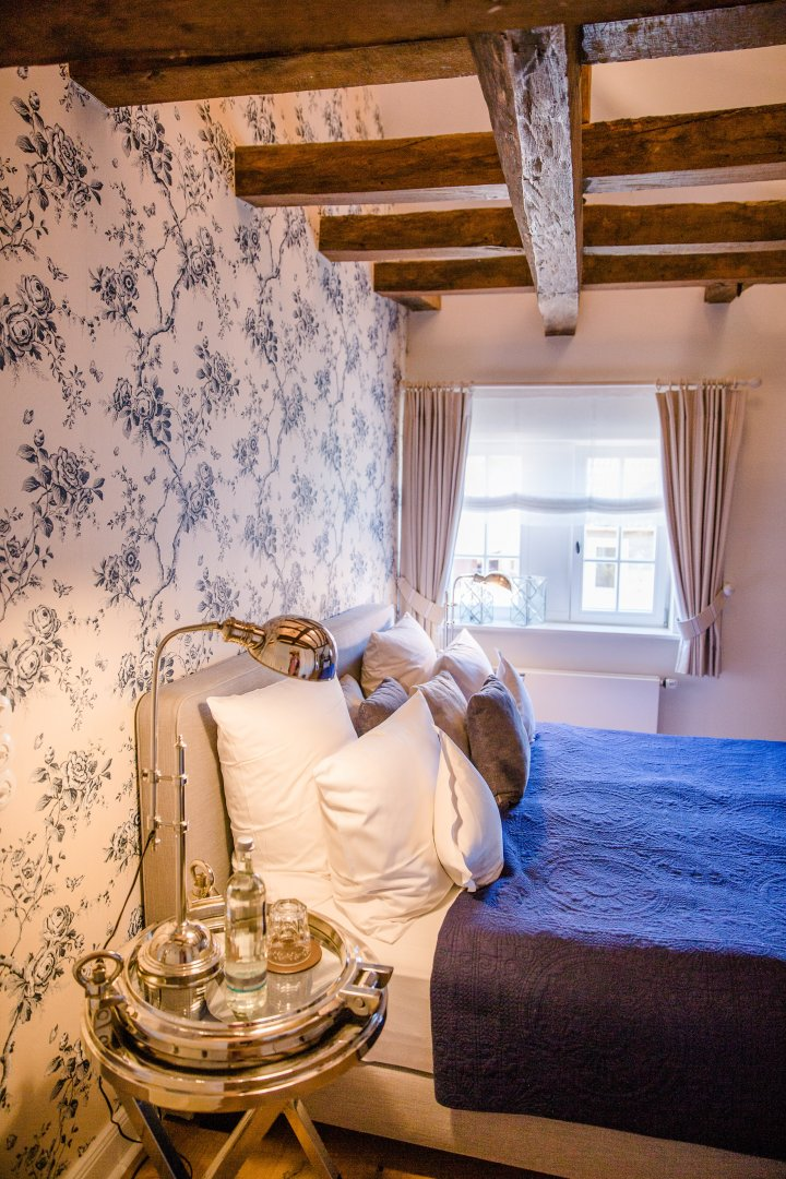 Room Bedroom Blue Furniture Property Interior design Bed House Ceiling Textile Home Building Bed sheet Suite Comfort Bedding Canopy bed Curtain Chair Floor Boutique hotel